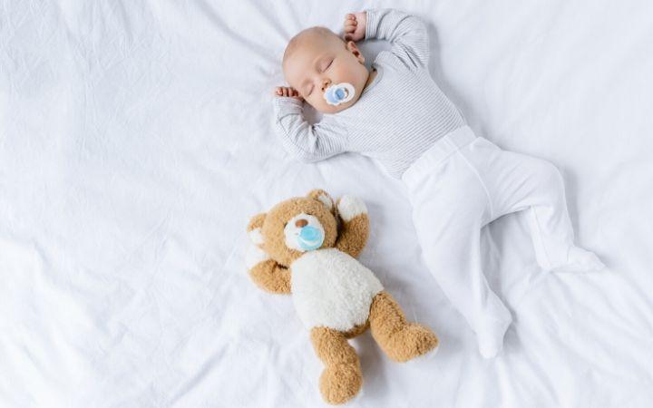 Baby and toy sleeping - The Proud Italian