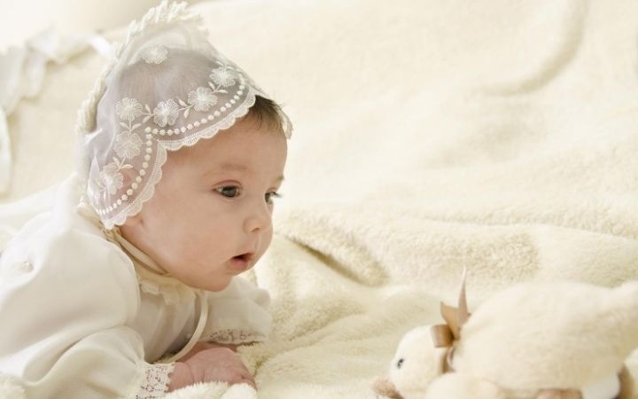 Baby dressed up to get baptized, common Italian names by saints - The Proud Italian