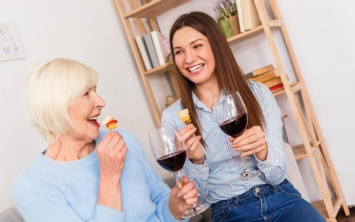Mother and daughter eating antipasto and drinking wine - The Proud Italian