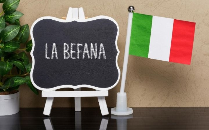 La Befana written on board and Italian flag - The Proud Italian