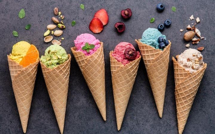 Various Italian gelato flavors in cones - The Proud Italian