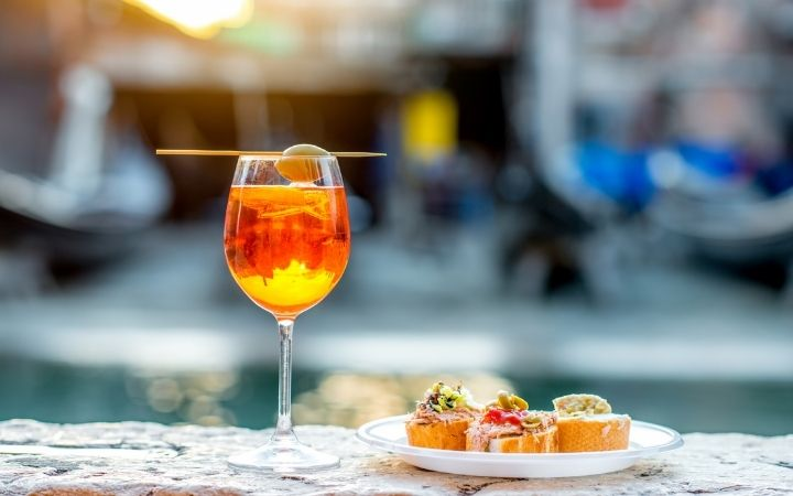 Spritz Aperol with cicchetti, Italian Aperitivo – What is it and how to enjoy it - The Proud Italian