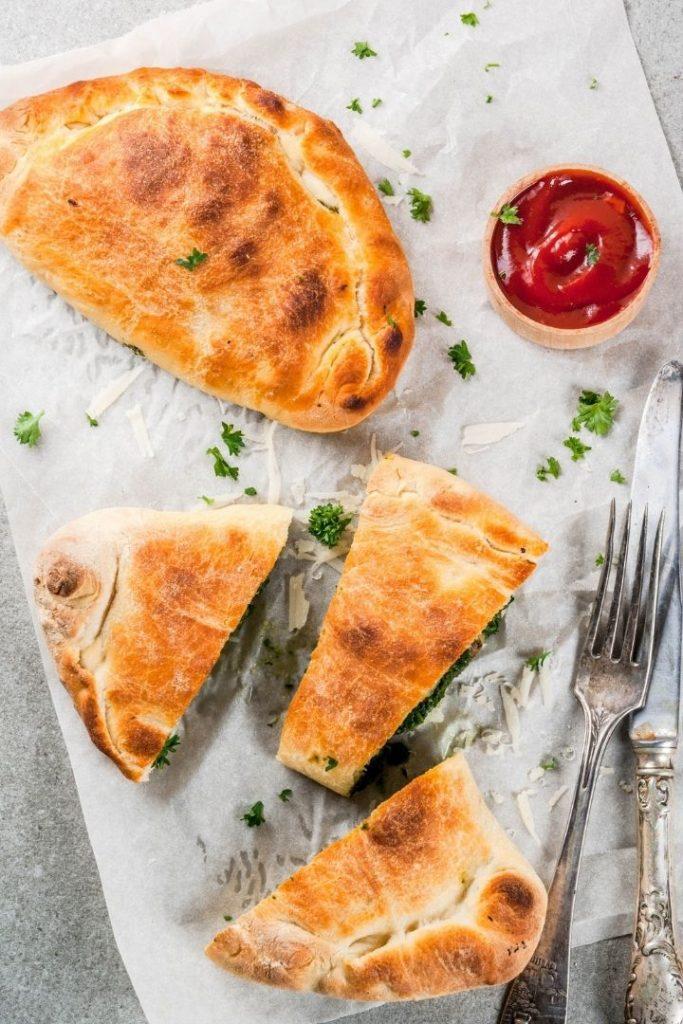 Calzone with sauce, Stromboli vs. Calzone - The Proud Italian