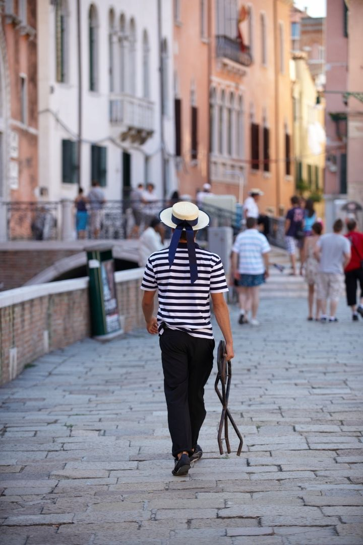 Gondolier, The Gondola Driver And His Steed - The Proud Italian