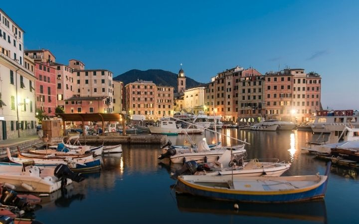 Camogli city viewed from the harbour with boats - The Proud Italian