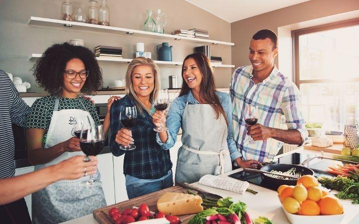 Friends preparing food in cooking school Italy - The Proud Italian