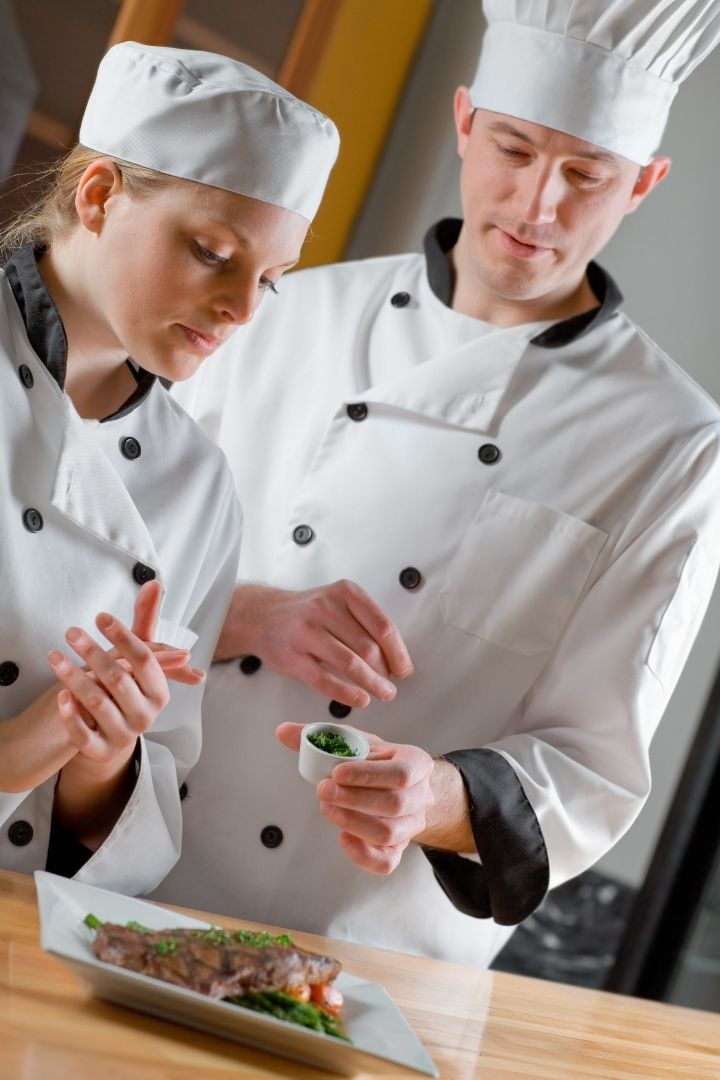 Chef and student in school of culinary arts preparing a meal - The Proud Italian