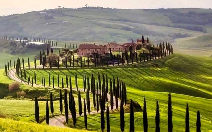 Tuscany fields with road to house - The Proud Italian