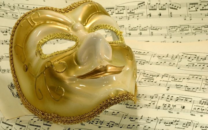 Mask on music sheet for Italian opera - The Proud Italian