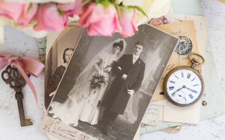 Old family photo with flowers and old watch beside - The Proud Italian