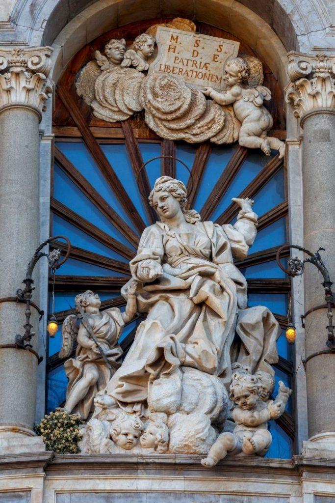 Statue on Church of St. Agatha of Sicily - The Proud Italian