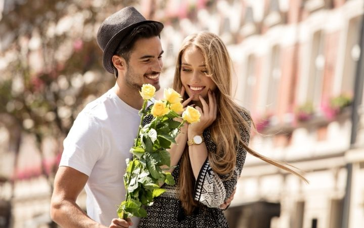 Couple on a date with yellow roses - The Proud Italian