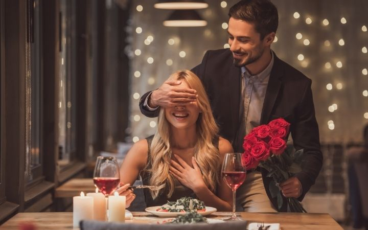 Date night and couple in a restaurant - The Proud Italian