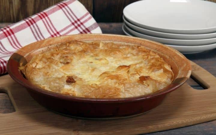 Italian Easter pie on cutting board - The Proud Italian