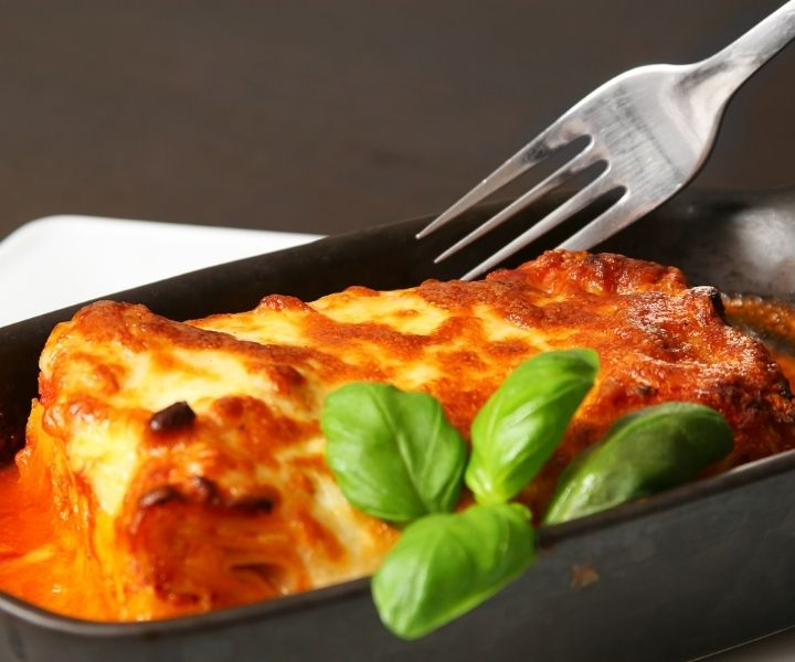 lasagne in bowl on plate