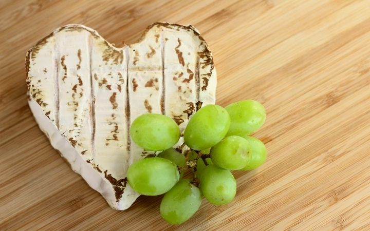 heart shaped neufchatel cheese wedge with green grapes