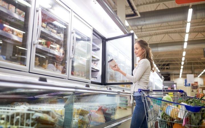 shopper getting cream cheese